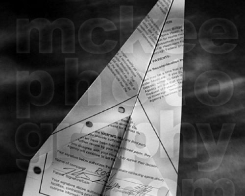 black and white of a paper airplane