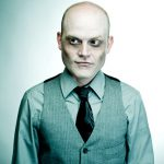 Balding Zombie with cynical look