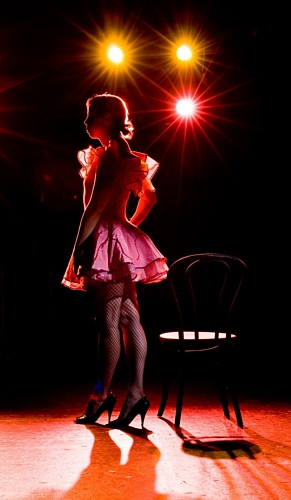 Cabaret Dancer on stage, silouetted against the stage lights