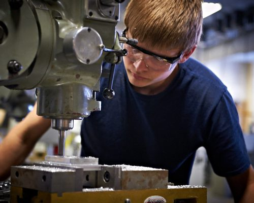 action photo of student with milling machine