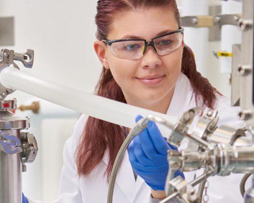 Lab technician with bioreactor